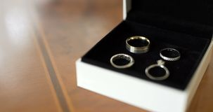 Wedding Rings in Decorated Box. Shoot of two wedding rings in a box on table stock video