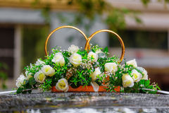 Wedding rings decorated with flowers Royalty Free Stock Images
