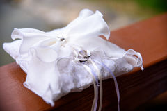 Wedding rings on a decorative pillow  the nature Royalty Free Stock Photos