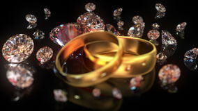 Wedding rings and diamonds Royalty Free Stock Photography