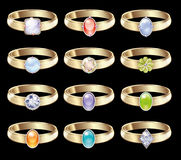 Wedding rings with diamonds. A set of wedding rings in a vector. Magnificent golden rings with colored stones. Glittering diamonds, emeralds, topaz, ruby Royalty Free Stock Image