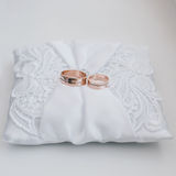 Wedding rings with diamonds on a white silk pillow with laces Royalty Free Stock Photography