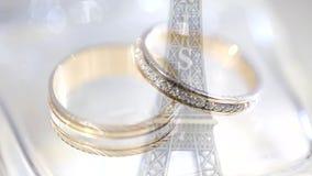 Wedding rings on the Eiffel Tower. Wedding rings lie on the Eiffel Tower. Symbol of Paris. Wedding rings on the Eiffel Tower. wedding rings lie on the Eiffel stock video