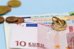 Wedding rings on Euro money Royalty Free Stock Photography