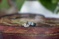 Wedding rings on a farmhouse table Royalty Free Stock Image