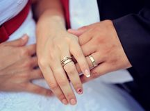 Wedding rings on fingers Stock Images