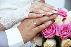 Wedding rings on fingers, hands Stock Images