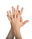 Wedding rings on the fingers of male and famale hands Stock Images