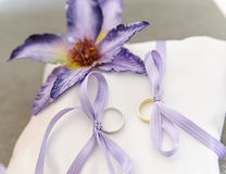 Wedding Rings with Flower Stock Images