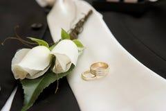 Wedding rings & flower. Grooms wedding flower & wedding rings Stock Images