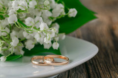 Wedding rings with flower background. Wedding rings on plate with flower background Stock Images