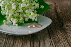 Wedding rings with flower background. Wedding rings on plate with flower background Stock Photos