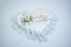 Wedding rings and flower. Two gold wedding rings and small flowers Royalty Free Stock Photo