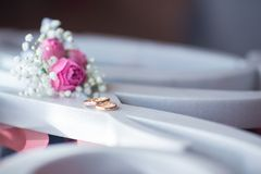 Wedding rings with flowero on sighn royalty free stock photography