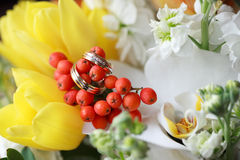 Wedding rings on the flowers Stock Image