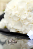 Wedding Rings with flowers. Wedding Rings detail with white flowers Stock Photos
