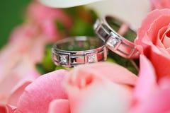 Wedding rings on the flowers. Beautiful wedding rings on the flowers Royalty Free Stock Image