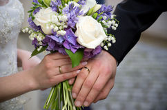 Wedding rings flowers. Wedding rings with a bouquet of flowers