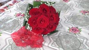 Wedding rings on flowers. Wedding rings on wedding bouquet flowers stock footage