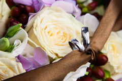 Wedding rings with flowers Royalty Free Stock Photo