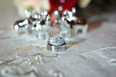 Wedding rings and flowers. Wedding rings with bridal bouquet Royalty Free Stock Image