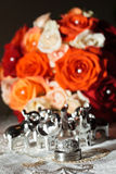 Wedding rings and flowers. Wedding rings with bridal bouquet Stock Photography