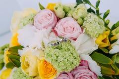 Wedding rings flowers bride`s bouquet. Wedding rings on the flowers of the bride`s bouquet Royalty Free Stock Photos