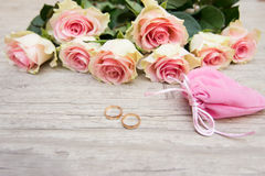 Wedding rings and flowers Stock Image