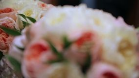 Wedding rings on flowers, dynamic change of focus stock footage