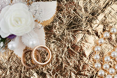 Wedding rings and flowers on a  fabric Stock Photo