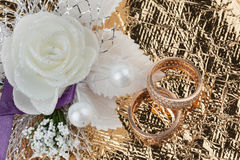 Wedding rings and flowers on a  fabric Royalty Free Stock Photography