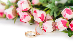 The wedding rings and flowers isolated on white background. Wedding rings and flowers isolated on white background Stock Images