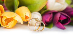 The wedding rings and flowers isolated on white background. Wedding rings and flowers isolated on white background Stock Photos
