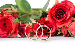The wedding rings and flowers isolated on white background Royalty Free Stock Image