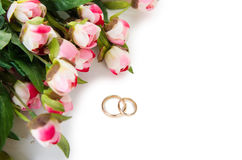 The wedding rings and flowers isolated on white background. Wedding rings and flowers isolated on white background Stock Image