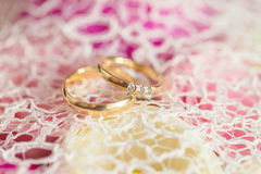 Wedding rings on the flowers and lace Stock Photo