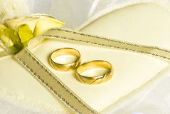 Wedding rings and flowers over veil Royalty Free Stock Images