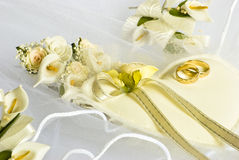 Wedding rings and flowers over veil Stock Images