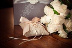 Wedding rings and flowers. Rose and glass Stock Photography