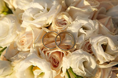 Wedding rings on flowers. Wedding rings standing on a bunch of flowers Stock Image