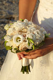 Wedding rings on flowers. Wedding rings standing on a bunch of flowers Stock Photo
