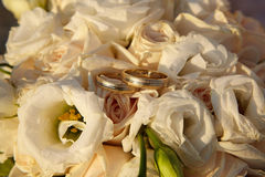 Wedding rings on flowers. Wedding rings standing on a bunch of flowers Stock Photography