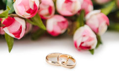The wedding rings and flowers  on white background. Wedding rings and flowers  on white background Stock Photography
