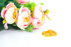 Wedding rings with flowers. On white background Stock Photos