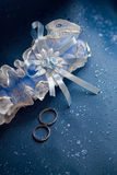 Wedding rings and garter Stock Photo