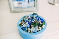 Wedding rings with a gems in a blue round box with blue flowers. Artwork. Soft focus Royalty Free Stock Images