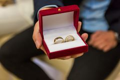 Wedding rings in gift box close up stock photo