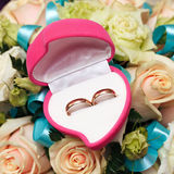 Wedding rings, gift box and flowers for  bride. Stock Photo