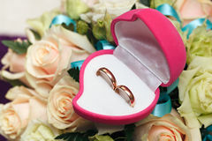 Wedding rings, gift box and flowers for  bride. Royalty Free Stock Image