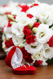 Wedding rings, gift box and flowers for  bride. Royalty Free Stock Photo